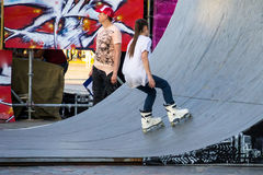 Aggressive rollerblading competition. Public event Stock Photos
