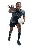 Aggressive rugby player gesturing while holding ball Royalty Free Stock Images