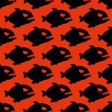 Aggressive seamless pattern from Piranha. Fish silhouettes with Stock Photography