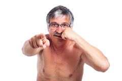 Aggressive senior man. Gesturing with fist and pointing at you, isolated on white background Stock Photos