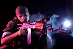 Aggressive soldier in uniform with rifle Royalty Free Stock Image