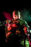 Aggressive soldier with weapon. Focus on face Royalty Free Stock Photography