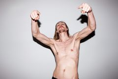Aggressive strong man. Male showing off muscles Stock Images