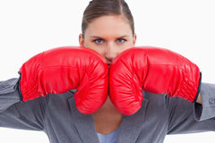 Aggressive tradeswoman with boxing gloves Royalty Free Stock Photo