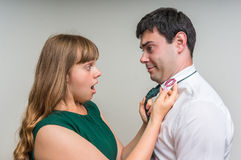 Aggressive wife revealed red lipstick on shirt collar Royalty Free Stock Image