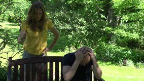 Aggressive wife shout husband near park bench. 4K stock video