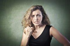 Aggressive woman stock photos