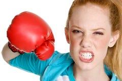 Aggressive Woman. Beautiful aggressive angry woman boxer royalty free stock photography