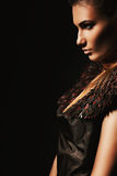 Aggressive woman in brown accessory. In dark Royalty Free Stock Photography