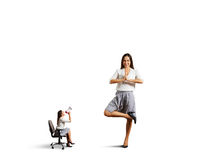 Aggressive woman and calm woman in asana Royalty Free Stock Photos