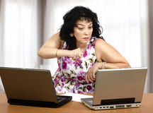 Aggressive woman in front of laptops Royalty Free Stock Image
