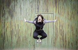 Aggressive woman jumps Stock Photo