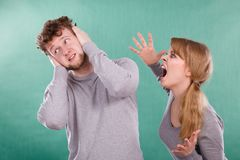 Aggressive woman yelling on man. Stock Photography