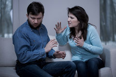 Aggressive woman. Young aggressive women and her afraid husband Royalty Free Stock Images