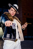 Aggressive young gangster with a gun Royalty Free Stock Images