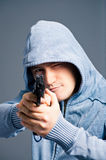 Aggressive young guy with gun Stock Photos