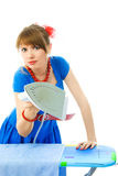 Aggressive young hosuewife ironing the towel. Aggressive young housewife ironing the towel against white background Stock Photos