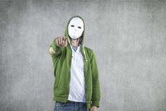 Aggressive young man in the mask Stock Images