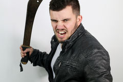 Aggressive young man with a sword. On a white background Royalty Free Stock Image