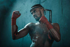 Aggressive young Muay thai boxer training thai boxing. Ultimate fight concept Royalty Free Stock Photos