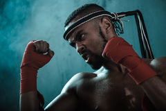 Aggressive young Muay thai boxer training thai boxing. Ultimate fight concept Royalty Free Stock Photography