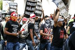 Aggressive youth provoking police at GST rally in KL Stock Images