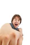 Aggressivt i kampen som gör en gest ingen skräck som försöker att stansa Arkivbild