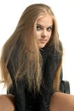 Aggressor. Smiling girl in aggressive outfit Royalty Free Stock Images