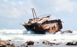 Aghullas shipwreck lying on the rocks stock photos