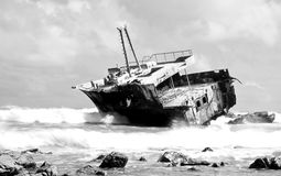 Aghullas shipwreck lying on the rocks Stock Images