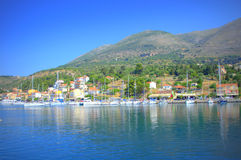 Agia Efimia harbour. Scenic view of Agia Efimia or Aghia Effimia-pretty fishing village and harbour, seen from the serene blue water of Ionian Sea,Kefalonia Stock Image