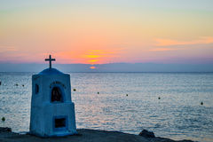 Agia marina monument drowned by the sea at sunset. Greece. Stock Image
