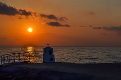 Agia marina monument drowned by the sea at sunset. Greece. royalty free stock photo