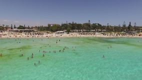 AGIA NAPA, CYPRUS - JUNE 2016 - Aerial view of Nissi beach with vacationers. Aerial view of Nissi beach with vacationers stock video