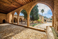 Agia Napa monastery courtyard arches in Cyprus 7. A view of the Agia Napa monastery courtyard with its arches and fountain in Cyprus stock image