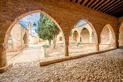 Agia Napa monastery courtyard in Cyprus 5. A view of the Agia Napa monastery courtyard with its arches and spire in Cyprus Royalty Free Stock Images