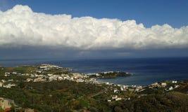 Agia Pelagia. Clouds and blue sky over Agia Pelagia. Crete. Greece Stock Photography