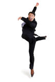 Agile businessman doing a pirouette. Fun portrait of an excited agile businessman in smart shoes and a suit performing ballet doing a pirouette,  on white Stock Photos