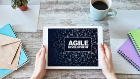 Agile development concept on the device screen. Agile development concept on the device screen royalty free stock photo