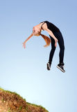 Agile funky young woman jumping Stock Photography