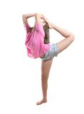 Agile teenage dancer bringing leg to head Royalty Free Stock Photo