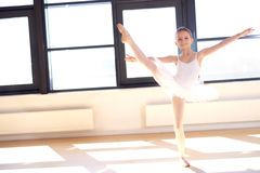Agile young ballerina practicing her positions Royalty Free Stock Image