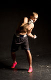 Agile young boxer moving around in the ring Royalty Free Stock Photos
