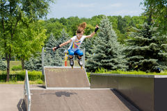 Agile young female roller skater Stock Photos