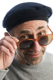 Aging artist thinking distorted nose  beret hat. Middle age senior man wearing artist french hippie beret hat macro close up distorted large nose face retro Royalty Free Stock Photo