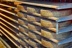 Aging cheese in a cellar of the Maison du Gruyere Stock Photos