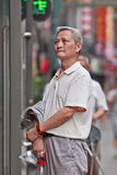 Aging Chinese man in the city center, Beijing, China Stock Photography