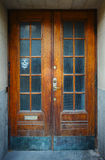 Aging door with ghost face Stock Photos