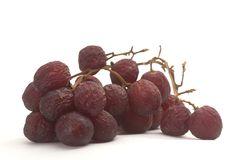 Aging grapes. On white background Royalty Free Stock Photography