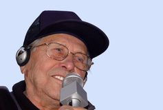 Aging happily. An old man singing Royalty Free Stock Photo